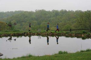 Pleasant Ridge Waldorf class farm trip, students walking by a pond